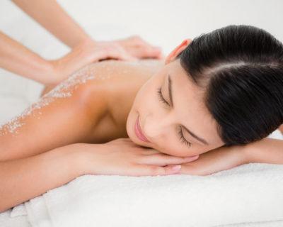 42398552 - woman enjoying a salt scrub massage at the health spa
